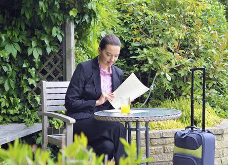 Caucasian businesswoman working in garden LANG_EVOIMAGES