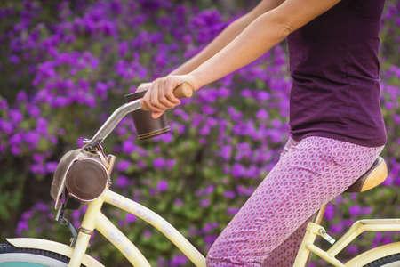 Hispanic woman riding bicycle LANG_EVOIMAGES