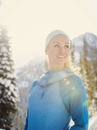 Caucasian woman smiling in snow