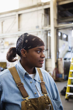 African female worker in warehouse LANG_EVOIMAGES