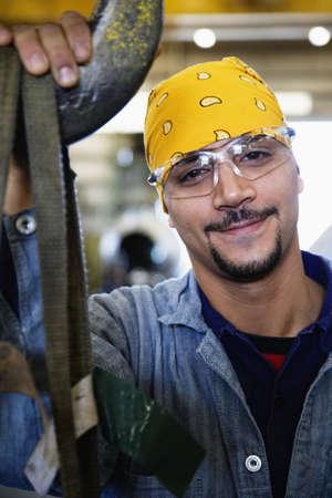 Close up of Hispanic man wearing protective eyewear LANG_EVOIMAGES