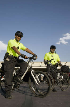 African police officers on bicycles