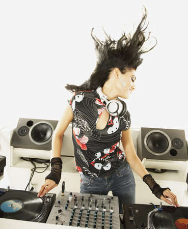 Hispanic dj with turntable and sound mixer