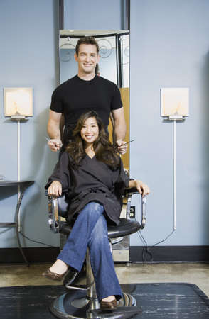 Male hair stylist and client in salon LANG_EVOIMAGES