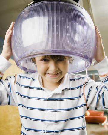 Portrait of boy under hair dryer LANG_EVOIMAGES