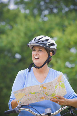 Senior Hispanic woman riding bicycle