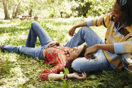 Multi-ethnic couple relaxing outdoors