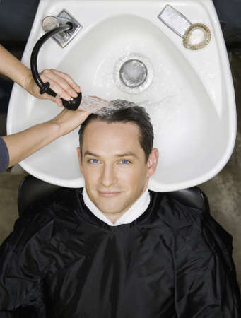 Man having hair washed at salon LANG_EVOIMAGES