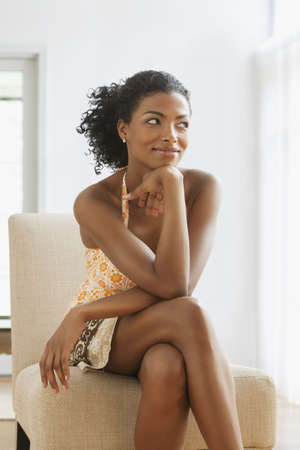 African woman sitting in chair