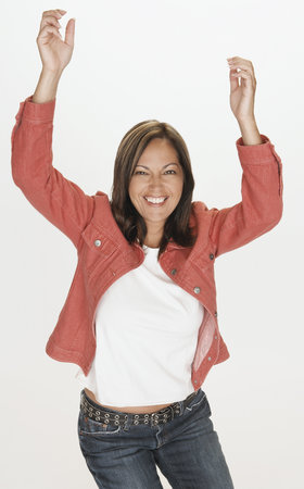 Portrait of Hispanic woman smiling with arms raised LANG_EVOIMAGES