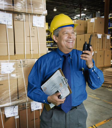 Hispanic man working in warehouse LANG_EVOIMAGES