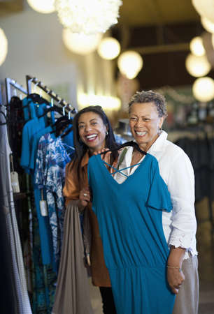Mother and daughter shopping together LANG_EVOIMAGES