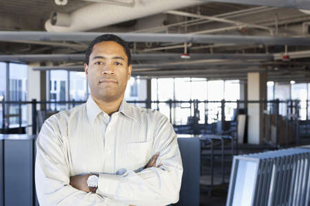 Black businessman standing in new office
