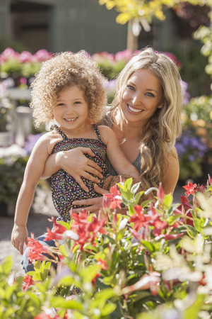 Mother and daughter at plant nursery