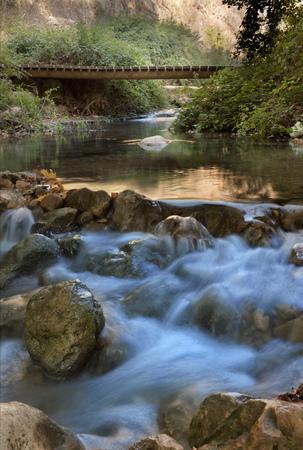 Kziv River Flowing Over Rocks LANG_EVOIMAGES