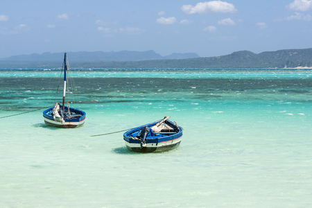 Fishing boats in the Emerald Sea LANG_EVOIMAGES
