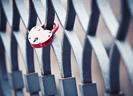 A heart shaped lock left by two lovers on a bridge railing in the city of love,Venice,Italy