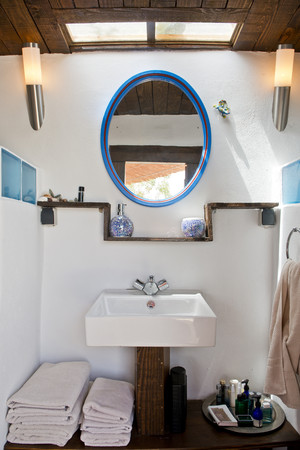 A small bathroom interior,with basin and mirror