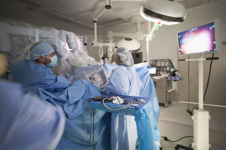 Surgeons working on patient in operating room