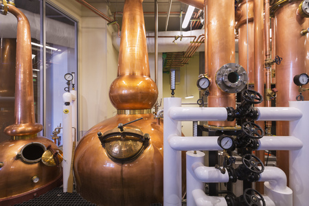 Copper stills in distillery LANG_EVOIMAGES