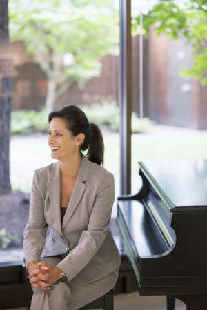 Caucasian businesswoman smiling in office LANG_EVOIMAGES