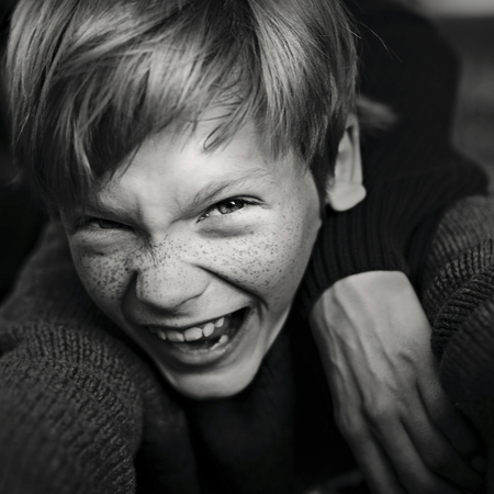 Caucasian boy with freckles laughing