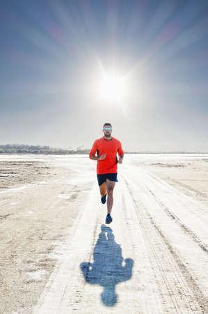 Hispanic man running in sunny landscape LANG_EVOIMAGES