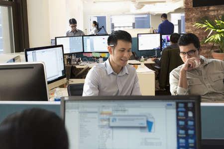 Businessmen working at desk in office LANG_EVOIMAGES