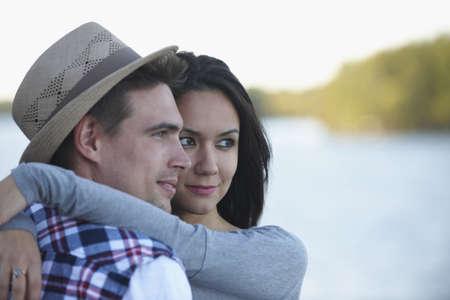 Couple hugging at lake