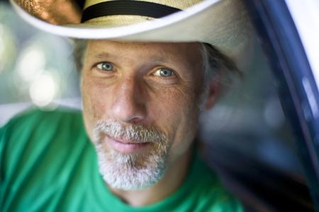 Smiling man wearing cowboy hat