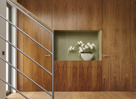 Flowers and walnut wall covering in home LANG_EVOIMAGES