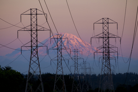 Electricity pylons near mountain landscape