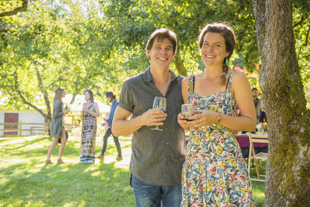 Portrait of smiling Caucasian couple drinking wine outdoors LANG_EVOIMAGES