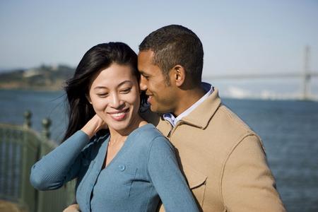Couple hugging at waterfront Banco de Imagens - 102038037