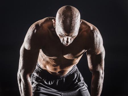 Sweating Black man bending and resting Banco de Imagens - 102038074