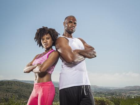 Portrait of confident sweating Black couple standing in landscape Banco de Imagens - 102038079