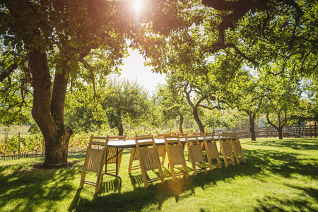Folded chairs leaning on table in backyard Banco de Imagens - 102038083