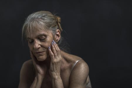 Portrait of pensive older Caucasian woman Banco de Imagens - 102038089