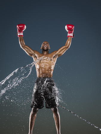 Water splashing on winning Black boxer