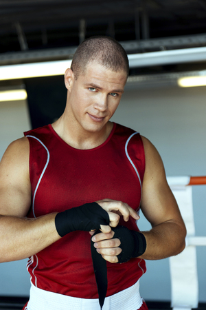 Caucasian boxer wrapping hands Banco de Imagens - 102038098