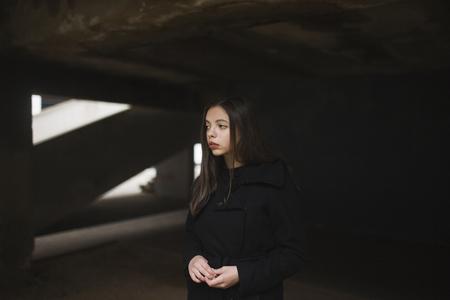 Pensive Caucasian woman wearing black coat Banco de Imagens - 102038102