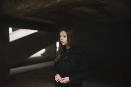 Pensive Caucasian woman wearing black coat LANG_EVOIMAGES