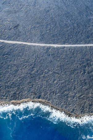 Aerial view of ocean waves on beach, Big Island, Hawaii, United States LANG_EVOIMAGES