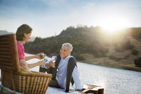 Couple enjoying wine at waterfront Banco de Imagens - 102038134