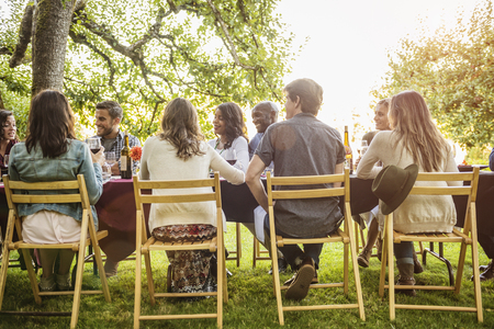 Friends enjoying wine at party outdoors Banco de Imagens - 102038136