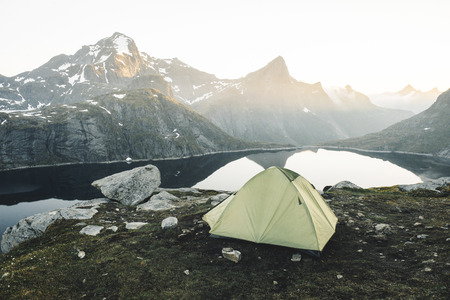 Camping tent near mountain lake