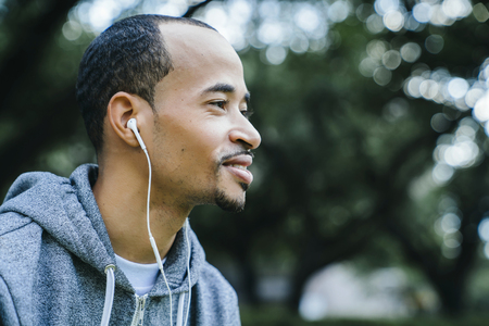 Black man listening to earbuds