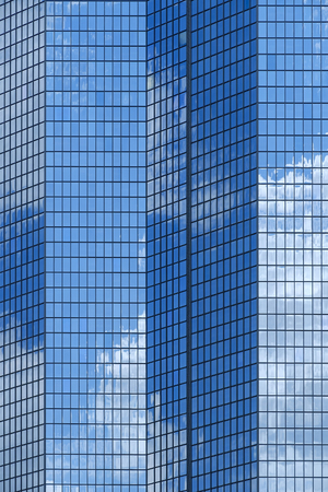 Reflection of blue sky and clouds in modern building windows Banco de Imagens - 102038175