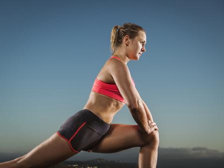 Caucasian runner stretching legs