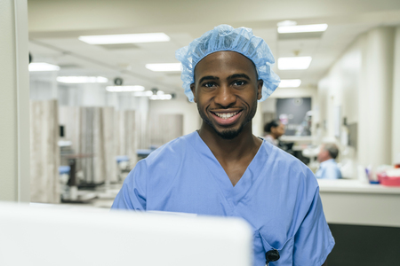 Portrait of smiling Black doctor in hospital LANG_EVOIMAGES